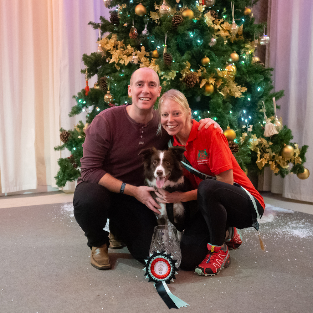 Natasha, Matt & Pebbles celebrating the Kennel Club Olympia Agility Dog of the Year win in 2018 - Photo by Yulia